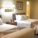 Our spacious double queen rooms are furnished with two queen sized beds,  table and 2 chairs, refrigerator, and microwave. Also, you have free access to fresh brewed coffee, hot chocolate, and tea at our coffee station. Join us in the morning for a wonderful continental breakfast. Enjoy your stay at the Big Sky Motel! Maximum Occupancy: 4